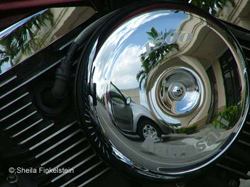 from the lens - motorcycle headlamp reflections