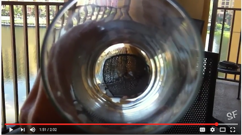 Video through a glass on balcony looking over water in http://TreasureYourLLifeNow.com